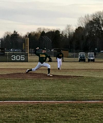 Nick Brueckert '19 puts the finishing touches on an opening day victory for the patriots. Brueckert caught the flip from Nick Bonk '18 to complete the groundout and finish the game.