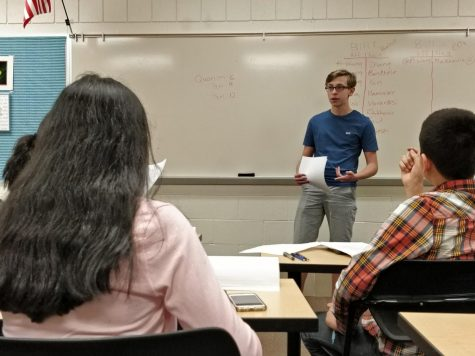 An Aptakisic student gives a speech during the middle school debate tournament while other students prepare to ask questions on May 2nd.  Aptakisic went on to win the tournament for the fifth year in a row.