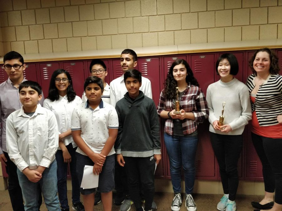 Aptakisic Junior High School debaters pose with their trophies after the tournament. Aptakisic won their 5th straight tournament title over Daniel Wright.