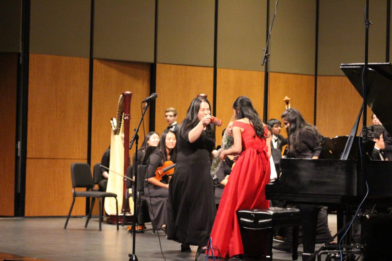 Julie Zhu '19 presents Stephanie Li '19 with a bottle of Sriracha. Li was the senior soloist for the concert.