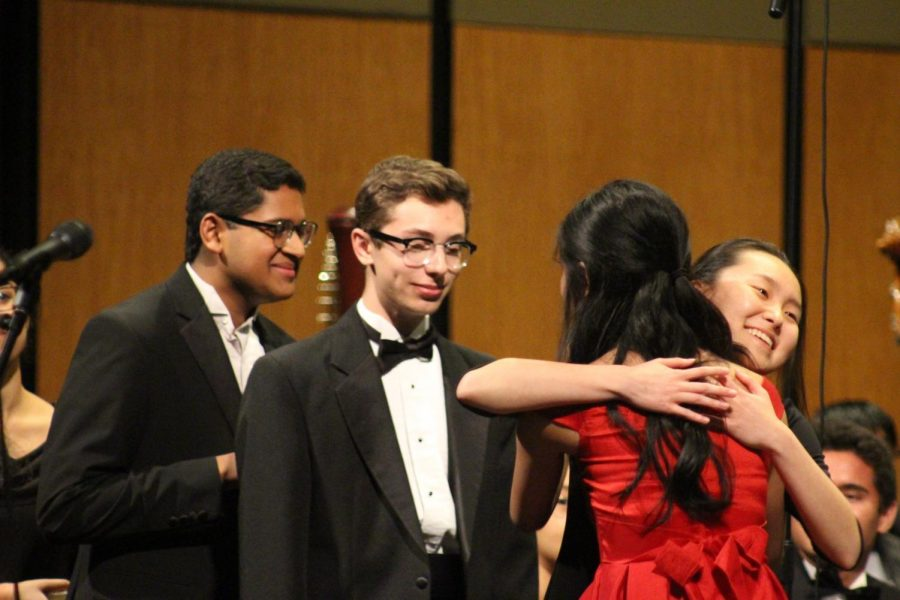 Erin Yuan '20, Sam Wachtel '19, and Achuth Raghunath '19 line up to congratulate Stephanie Li '19. Li was the soloist for the concert and performed Ravel's Piano Concerto in G Major, Movement No. 1