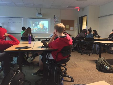 students intently watch a video regarding false confessions. The E-Board prepares presentations with videos relevant to the topic of meetings.