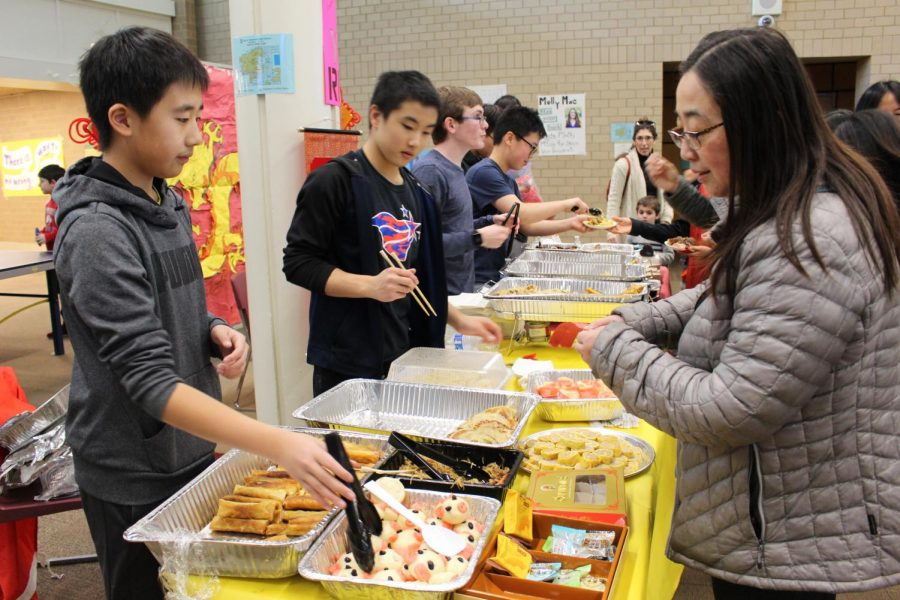 Andrew Wang '22 and other enthusiastic Chinese club volunteers served homemade Chinese food in exchange for tickets.  Spring rolls, bao zi, and scallion pancakes were all part of their authentic cuisine, which attending families and students enjoyed.