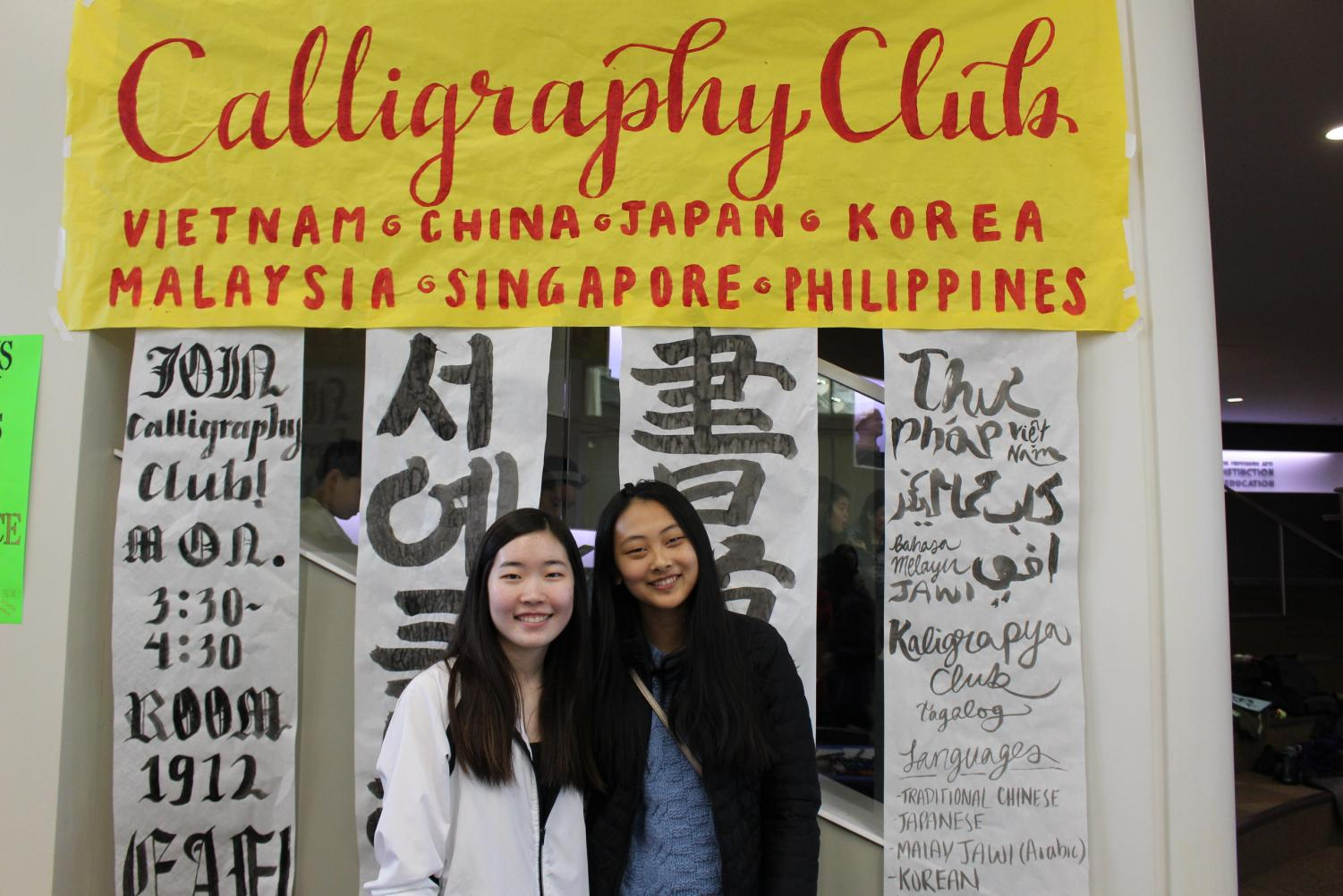 Calligraphy Club members Allison Liu '20 and Kara Lee '20 decorated their festival booth with exquisite brush strokes and watercolor pens.  The club also led a hands-on calligraphy activity for the children.
