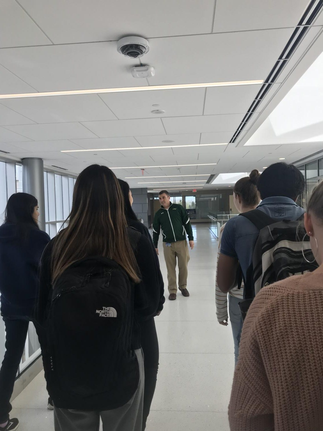 Students follow Mr.Gobble one of the main hallways of the new addition to the East Building. Classes are set to start in the new addition in fall of 2019. ​