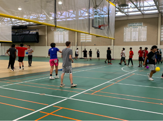 After a game, students to warm up before their next rounds.  The dodgeball tournament was bracket style, with a team being eliminated each game until there was only one left.